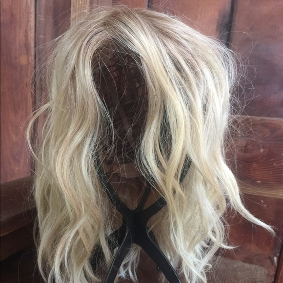 Natural looking synthetic wig. Never been worn.